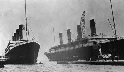 RMS Olympic entering the Thompson graving dock for repairs while Titanic is under construction. The over-hanging starboard bridge-wing can be seen in the photograph. Photo from author's collection.