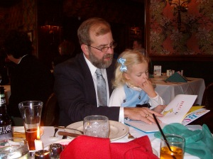 Daddy and Elizabeth reading Dr, Seuss Easter 2009