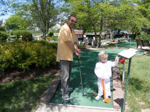 Daddy and Elizabeth playing put put golf at Young's Dairy 25 May 2008