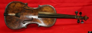 The violin of Wallace Hartley the bandleader of the Titanic. Found tied to his body when he was recovered. Photograph by AP