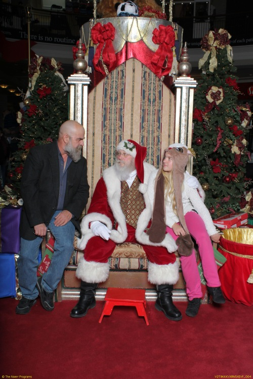 Daddy telling Santa Claus a story.